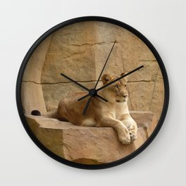 """Majestic Lioness, stiking a """"top cat"""" pose on a rocky ledge Wall Clock"""