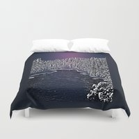 finland Duvet Covers featuring Winter river in Lapland Finland  by Guna Andersone & Mario Raats - G&M Studi