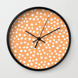 Orange and white doodle dots Wall Clock
