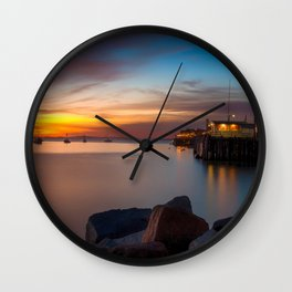 Here she comes again the sun rising at Port San Luis vila Beach Wall Clock