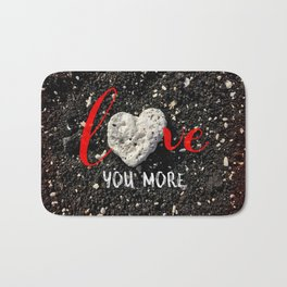 "Coral rock heart on Hawaii black sand | ""Love you more"" Bath Mat"