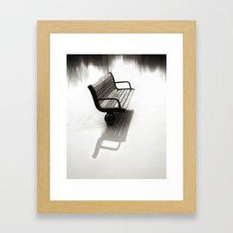 Bench almost flooded Framed Art Print