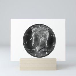 John F. Kennedy silver half dollar on white background Mini Art Print