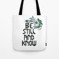 "bible verse Tote Bags featuring Hand-lettered bible verse ""be still and know"" with blue flowers by to florence with love"