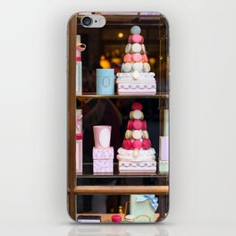 Beautiful colorful tasty macaroons cakes sweets and presents in the boxes display in window at the  iPhone Skin