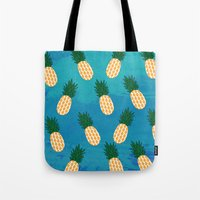 pineapples Tote Bags featuring Pineapples  by Ashley Hillman