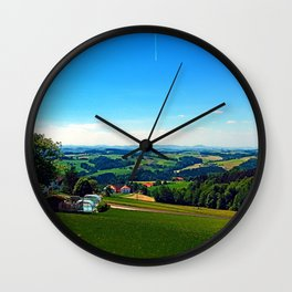 Condensation trail with some scenery Wall Clock