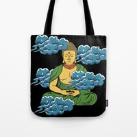 buddah Tote Bags featuring Sakyamuni Buddah In The Clouds by Sarah Eldred