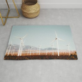 Wind turbine with mountain background in the desert at Kern County California USA Rug