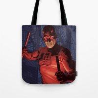 daredevil Tote Bags featuring Daredevil by Arne AKA Ratscape