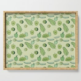 Cucumbers, peas, kiwi, apples, limes and greens on a light green background. Serving Tray