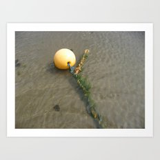 Yellow buoy bobbing on the sea Art Print