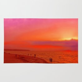 Sunset in orange and pink by the beach Rug