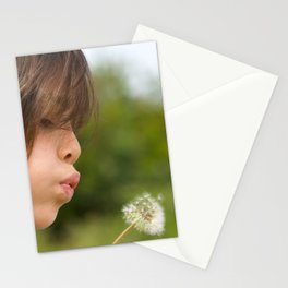 Beautiful little girl blow dandelion outdoor Stationery Cards