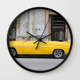 PARKED VINTAGE CLASSIC CAR NEAR CONCRETE WALL Wall Clock