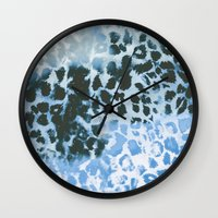 snow leopard Wall Clocks featuring Snow Leopard by Caleb Troy