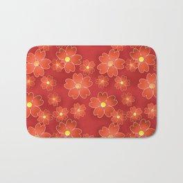 Red orange flowers on an orange background . Bath Mat