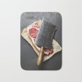 vintage cleaver and raw beef steak on dark background Bath Mat