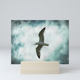 Seagull Before A Cloudy Sky Mini Art Print