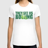 seahawks T-shirts featuring They See Us Rolling - Seattle Seahawks Michael Bennett on a Bicycle by Madeline Timm