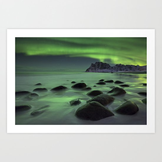 Aurora borealis over a beach on the Lofoten in Norway by sarawinter