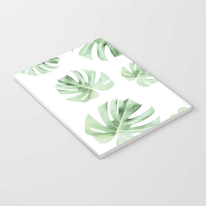 Tropical green leaves on white Notebook