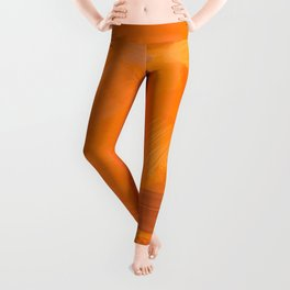 brush painting texture abstract background in orange brown Leggings
