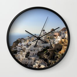 CONCRETE BUILDINGS AT SANTORINI  GREECE DURING DAYTIME Wall Clock