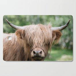 Portrait of a cute Scottish Highland Cattle Cutting Board