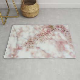 Beautiful pink cherry blossoms after winter Rug