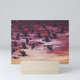 red-winged blackbird flock in flight Mini Art Print