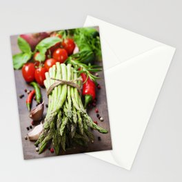 Fresh green asparagus bunch and vegetables on wooden board Stationery Cards
