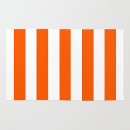 Willpower orange - solid color - white vertical lines pattern Rug