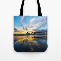 calendars Tote Bags featuring Sunset ~ Huntington Beach Pier CA  11/7/13 by John Minar Fine Art Photography