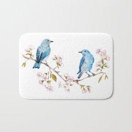 Mountain Bluebirds on Sakura Branch Bath Mat