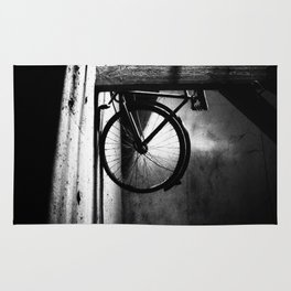 Old bicycle in a dusty attic Rug