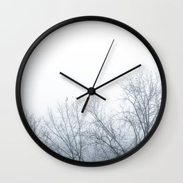Trees in a foggy day Wall Clock