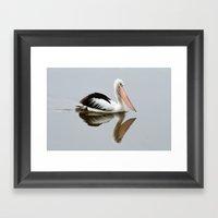 A Pelican Reflecting Framed Art Print