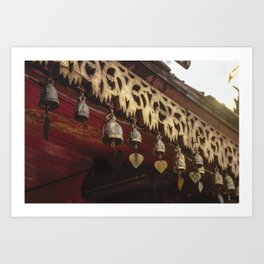 Intricate copper bells with clapper hearts, hanging from wooden ceiling in Doi Suthep. Art Print