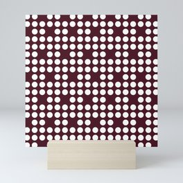 White dots on burgundy red Mini Art Print