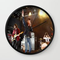arctic monkeys Wall Clocks featuring Arctic Monkeys in Williamsburg, New York by The Electric Blue / YenHsiang Liang