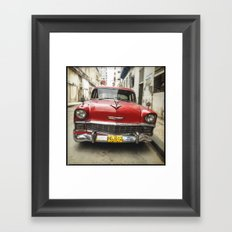 Vintage Red American Car on the Streets of Havana. Framed Art Print