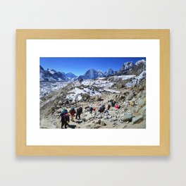 Trekking in Himalaya. Group of hikers  with backpacks   on the trek in Himalayas, trip  to the base  Framed Art Print