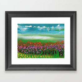 The meadow - A landscape in the background a blue sky and wildflowers Framed Art Print