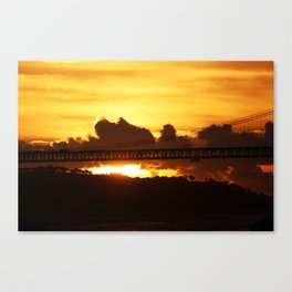 Dramatic sunset with bridge Canvas Print
