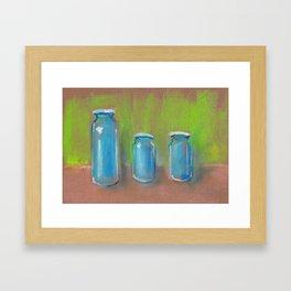 Stil-Life - Three blue bottles on a green pastel background. Framed Art Print