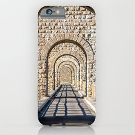 Stone arch in a row in selective focus iPhone Case