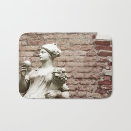 Old Brick Wall and Statue of a Woman Bath Mat