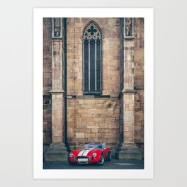 Red sportscar at a gothic cathedral wall Art Print