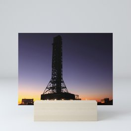 Lights appear in the crawler-transporter under the mobile launcher or ML as its 42-mile day-long tre Mini Art Print